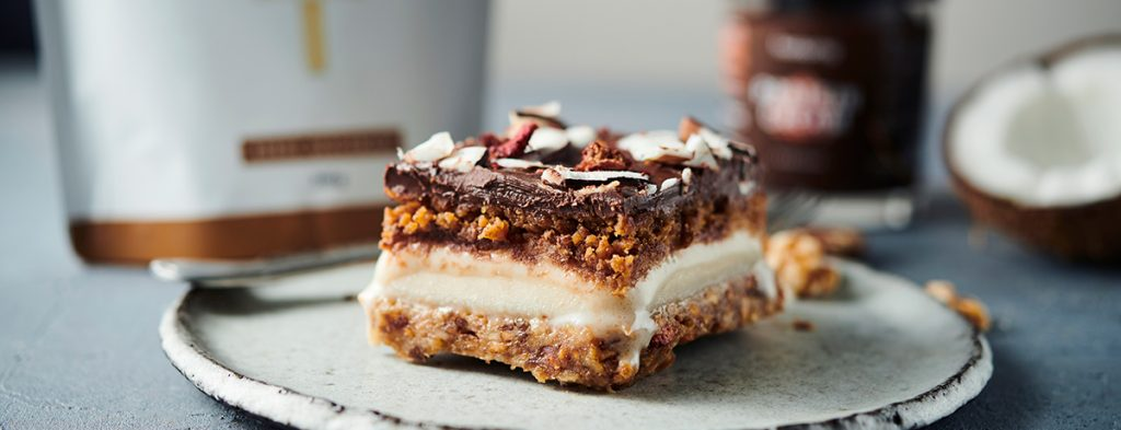 a five-layer protein ice cream cake sits on a plate